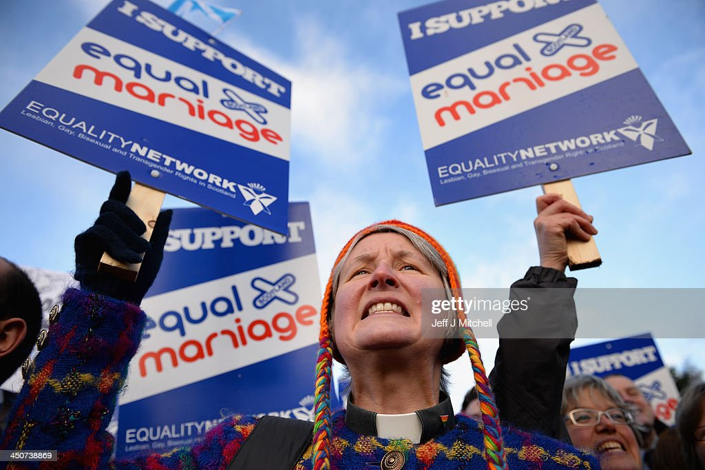 Campaigners from the Equality Network hold a rally outside the Scottish Parliament on November 20, 2013 in Edinburgh, Scotland. Memebers of the Scottish Parliament will vote later today on the Marriage and Civil Partnership Bill, debating on general principles of controversial Scottish Government proposals to allow gay couples to wed.