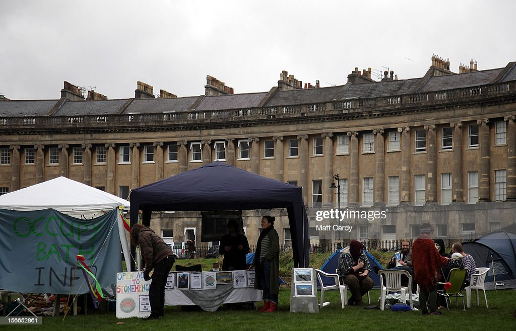 Campaigners from the Occupy Bath protest group gather in front of Bath's Grade 1 Royal Crescent on November 17, 2012 in Bath, England. The small group of local representatives of the Occupy movement - which staged an occupation in the city for six weeks last year - moved into Royal Victoria Park in front of the historic landmark on Friday night, but claimed they would end the protest on Sunday.