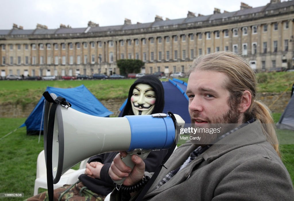 Campaigners from the Occupy Bath protest group sit in front of Bath's Grade 1 Royal Crescent on November 17, 2012 in Bath, England. The small group of local representatives of the Occupy movement - which staged an occupation in the city for six weeks last year - moved into Royal Victoria Park in front of the historic landmark on Friday night, but claimed they would end the protest on Sunday.