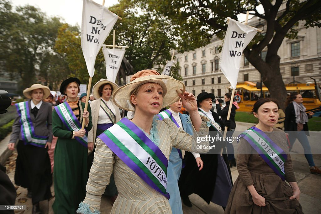 Campaigners, some dressed as suffragettes, attend a rally organised by UK Feminista to call for equal rights for men and women on October 24, 2012 in London, England. Hundreds of women from around the UK congregated in Westminster to attend a rally and lobby their local MPs to demonstrate against any legislation that damages women's rights.