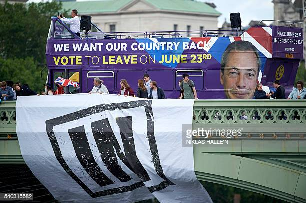 Campaigners to remain in the EU unfurl a banner on Westminster Bridge as a bus bearing the face of UKIP leader Nigel Farage and a message urging...
