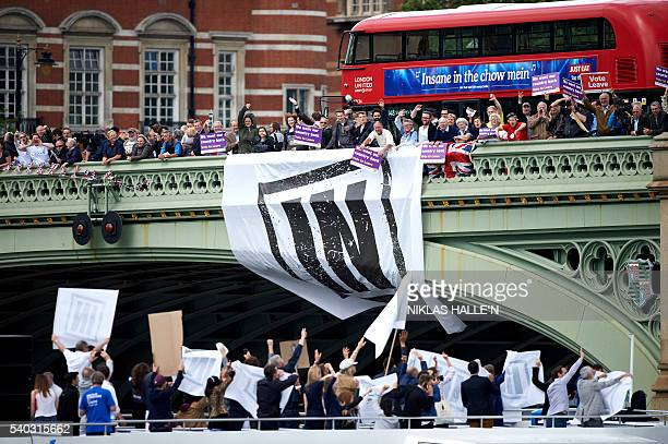 Campaigners to remain in the EU unfurl a banner on Westminster Bridge as they wait for a flotilla of boats from the group 'Fishing for Leave' to sail...