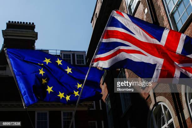 Campaigners wave an European Union flag and a Union flag also known as a Union Jack during an antiBrexit demonstration outside the Conservative Party...