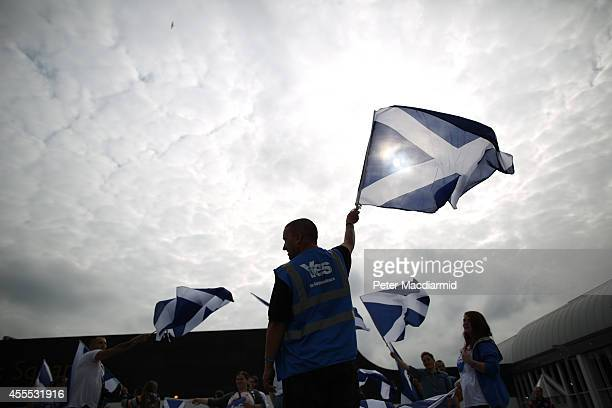 YES campaigners wave Saltire flags on September 16 2014 in Glasgow Scotland Yes and No supporters are campaigning in the last two days of the...