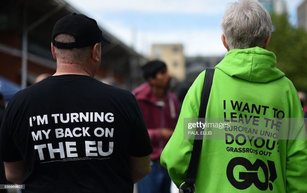 Campaigners wear clothing bearing the slogans 'I'm Turning My Back On The EU', and 'I Want To Leave The European Union, Do You?' as they attend a an Anti-EU (European Union) United Kingdom Independence Party (UKIP) pro-Brexit campaign event, in Birmingham, central England, on May 31, 2016, ahead of the forthcoming referendum. Politicians and world leaders have dominated the headlines in the campaign for Britain's Jun 23, 2016 EU referendum, but a passionate battle for the country's future is also being fought by activists on the streets. / AFP / PAUL