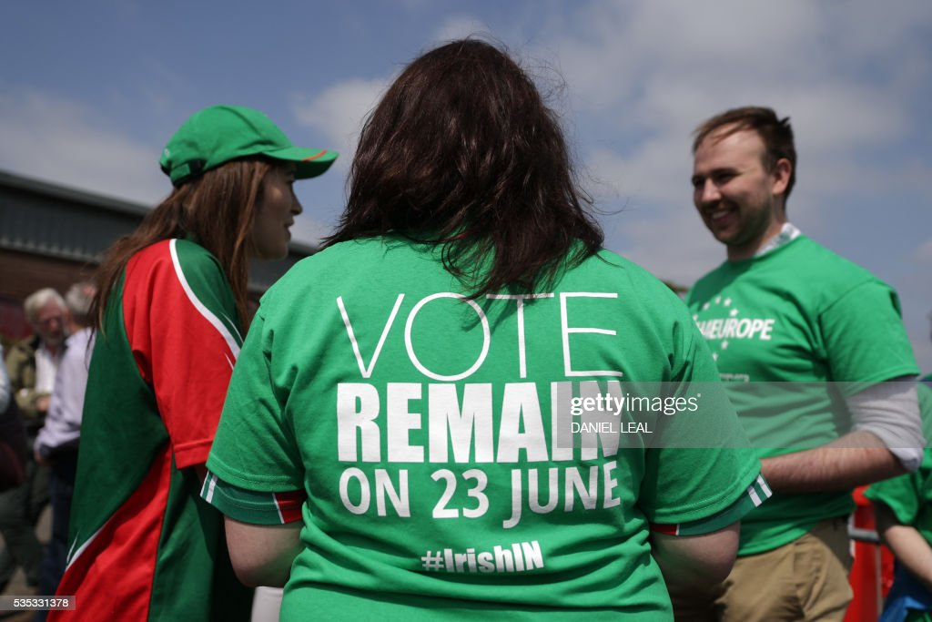Campaigners with the pro-Europe campaign group called 'Irish4Europe', an Irish group supporting the 'Remain' campaign for the forthcoming EU referendum, hands out leaflets to visitors to the London vs Mayo Gaelic Athletic Association (GAA) football game at Ruislip GAA grounds in Ruislip, northwest London, on May 29, 2016. Irish4Europe is a civic campaign to secure Britains future in the European Union. Activists were leafletting to raise awareness that Irish citizens living in the UK can vote in the EU referendum on June 23, 2016. / AFP / DANIEL
