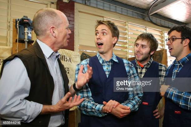 Campbell Newman Premier of Queensland talks to The Inbetweeners cast Joe Thomas James Buckley and Simon Bird during a visit to RNA Show Grounds on...