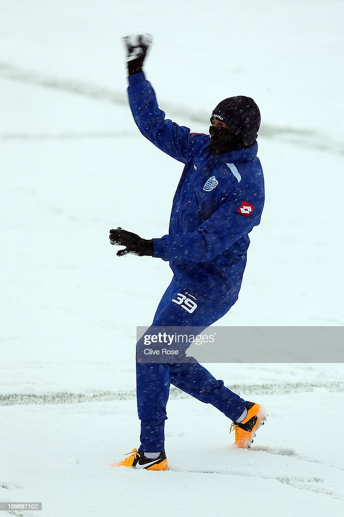 DJ Campbell of Queens Park Rangers plays in the snow during a Queens Park Rangers training session on January 18, 2013 in Harlington, England.
