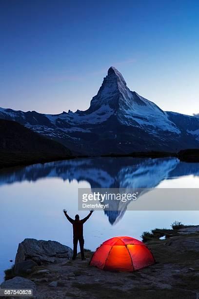 Camper at dawn looks to  Matterhorn