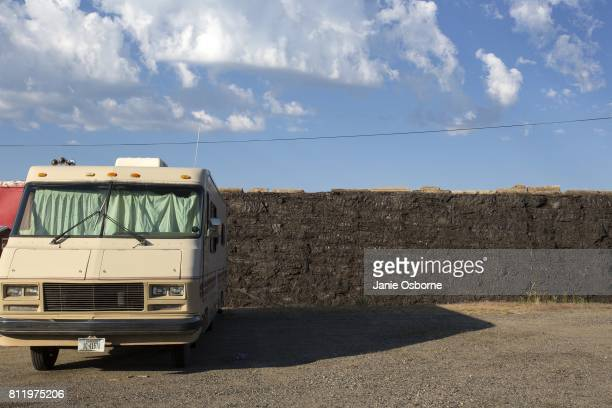 A camper is parked near a contaminated slag wall near downtown Butte on July 6 2017 in Butte Montana Butte is home to the toxic Berkeley Pit Formerly...