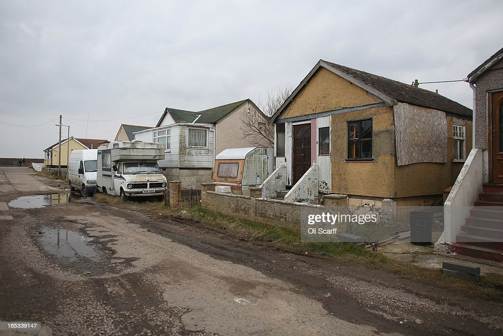 Camper trailers are parked near dilapidated properties stand in the seaside town of East Jaywick, the most deprived place in England, on April 3, 2013 in Jaywick, England. The Government's 2011 Indices of Multiple Deprivation' measure ranks Jaywick as the most deprived of all 32,482 small wards in England and Wales. The area also has the greatest number of young people not in employment, education or training; one third of 16 to 24 year-olds claim Jobseeker's Allowance, compared to the national average of 6 per cent. Changes to the benefits and tax system which came into force on April 1, 2013 have included a cut in housing benefit payments for working-age social housing tenants whose property is deemed larger than they need and council tax support payments now being administered locally.