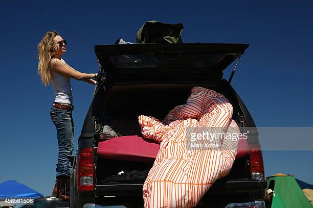A camper unpacks her vehicle on the first day of the 2014 Deni Ute Muster at the Play on the Plains Festival grounds on October 3 2014 in Deniliquin...