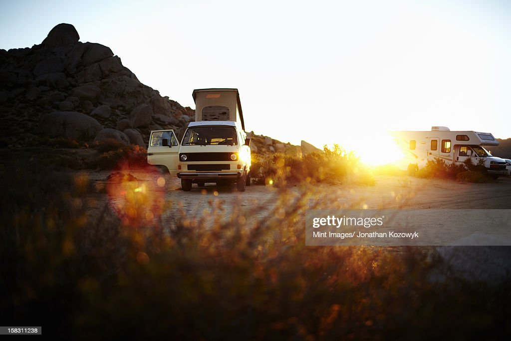 A camper van, a classic design, and an iconic travelling vehicle in Yosemite national park, at sunset. : Stock Photo