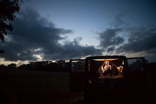 Camper van girls at dusk