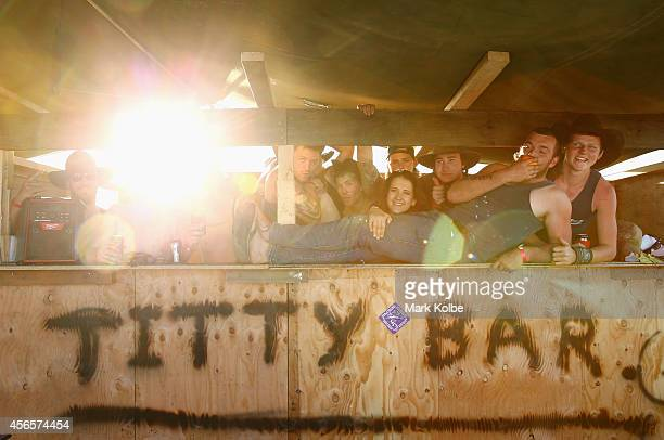 Campers at the Titty Bar in the 'Ute Paddock' pose as they enjoy the atmosphere on the first day of the 2014 Deni Ute Muster at the Play on the...