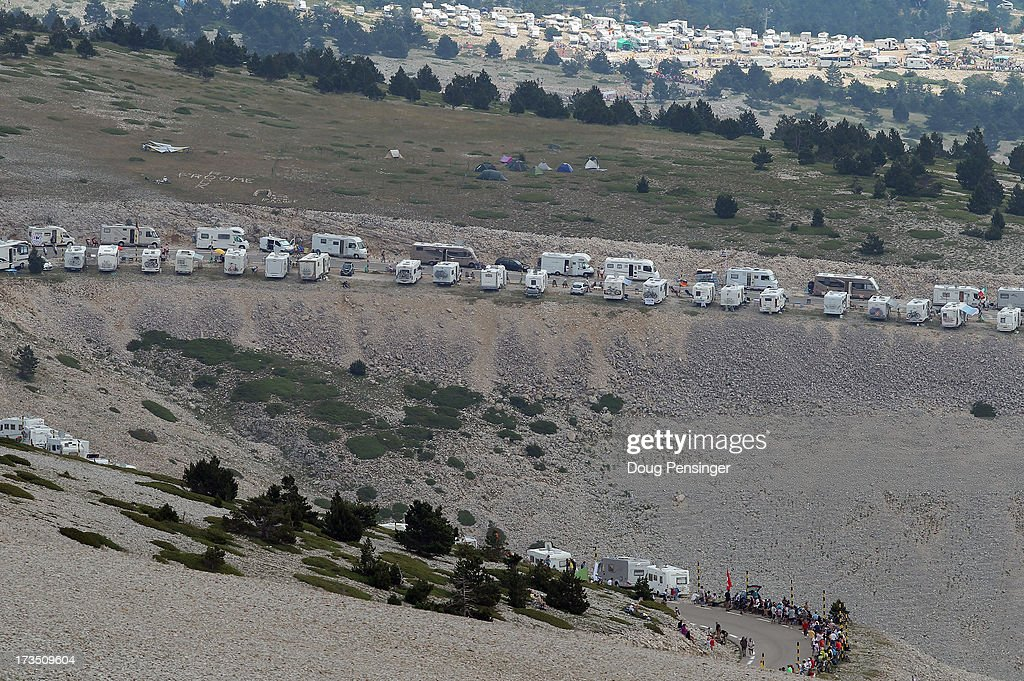 Campers clutter the slopes of the mountin as they await the cyclists during stage fifteen of the 2013 Tour de France, a 242.5KM road stage from Givors to Mont Ventoux, on July 14, 2013 in Mont Ventoux, France. Chris Froome of Great Britain riding for Sky Procycling won the stage and defended the overall race leader's yellow jersey.