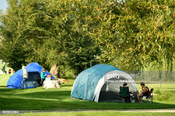 Campers enjoy a quiet breakfast at City Park on August 20 2017 in Lander WyomingCity Park has become a hot spot for campers to pitch tents for the...