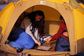 Campers Playing a Game in Their Tent