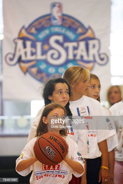 Campers run through drills underneath the New Orleans AllStar logo at the Jr NBA/Jr WNBA Basketball Camp on July 17 2007 at the Reilly Center Tulane...