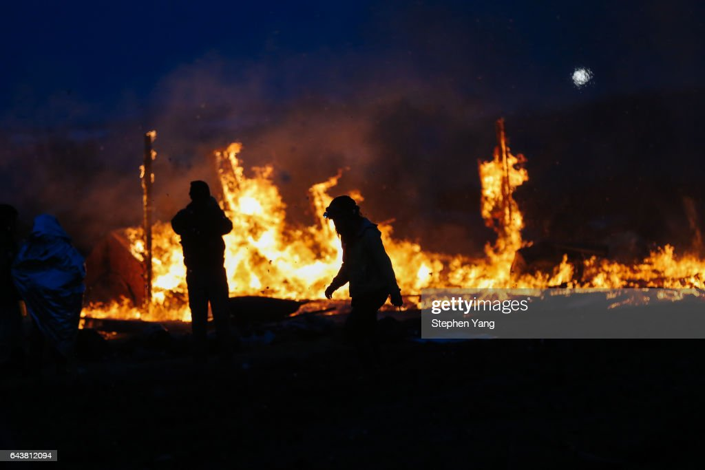 Campers set structures on fire in preparation of the Army Corp's 2pm deadline to leave the Oceti Sakowin protest camp on February 22, 2017 in Cannon Ball, North Dakota. Activists and protesters have occupied the Standing Rock Sioux reservation for months in opposition to the completion of the Dakota Access Pipeline.