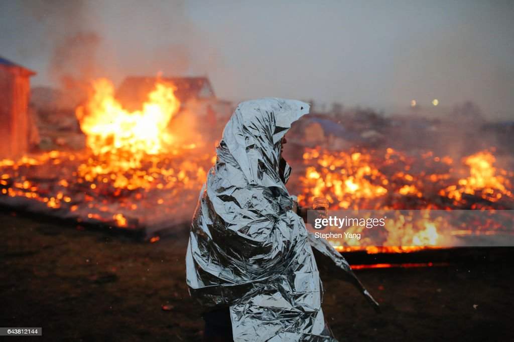 The Standing Rock camp is set to flames as one protester refuses to budge. This photo by Stephen Yang should win a Pulitzer