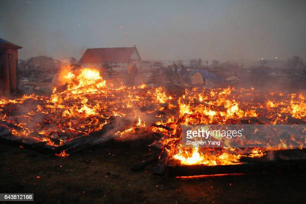 Campers set structures on fire in preparation of the Army Corp's 2pm deadline to leave the Oceti Sakowin protest camp on February 22 2017 in Cannon...