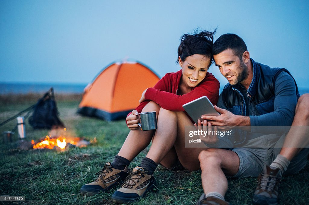 Campers with digital tablet : Stock Photo