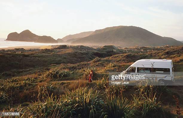 Campervan at Bethell's Beach on Waitakere Ranges coastline, near Auckland.