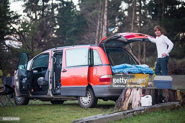 A campervan sets up a campsite