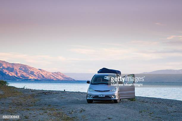 A campervan sets up a campsite.
