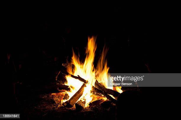A campfire burning at night