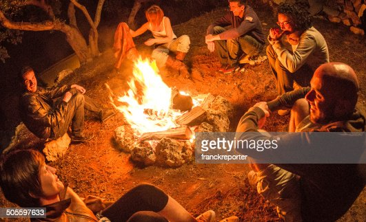 Campfire of friends in circle on the fire