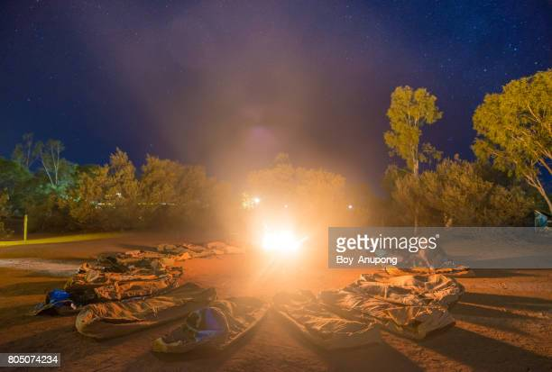Campfire under the stars in Australian outback.
