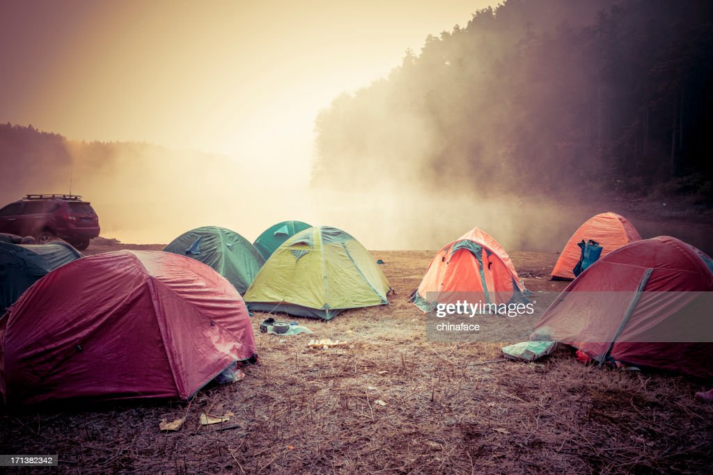 Campground aside river : Stock Photo