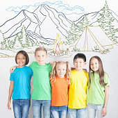 Summer vacation for group of friendly children together. Camp, camping, holidays. Happy kids resting at mountain. Healthy lifestyle. Friendship. After school.