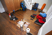 Camping equipment on floor of home