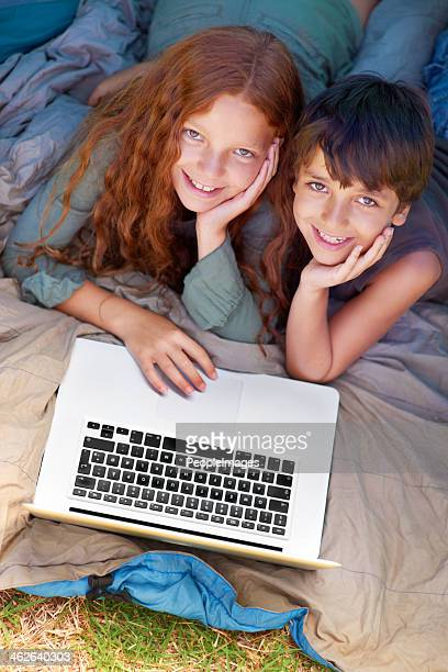 Camping fun with their computer