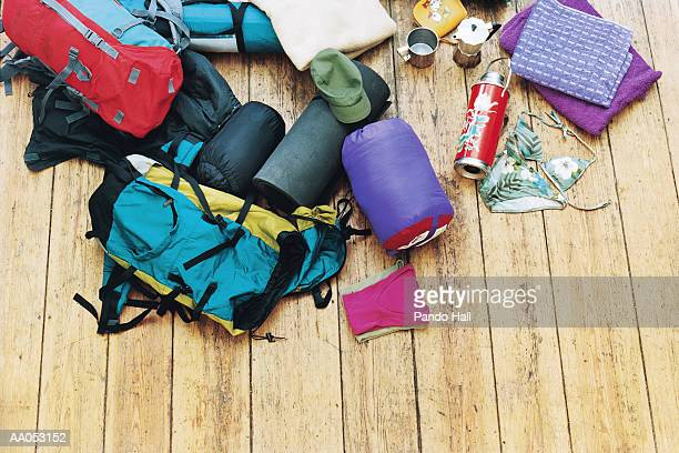 Camping gear scattered on wood floor, elevated view