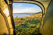 View from tent while camping along the coast of arctic Northern Norway.