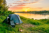 Camping tent in a camping in a forest by the Oka river. Russia