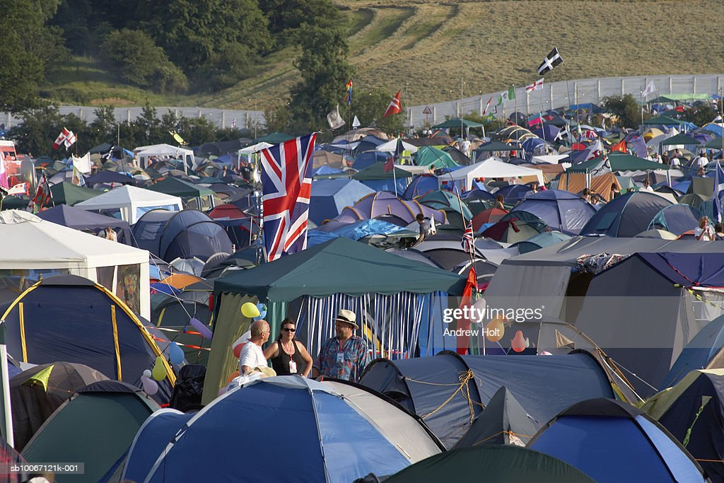 Camping tents with Union Jack flag at Glastonbury Festival