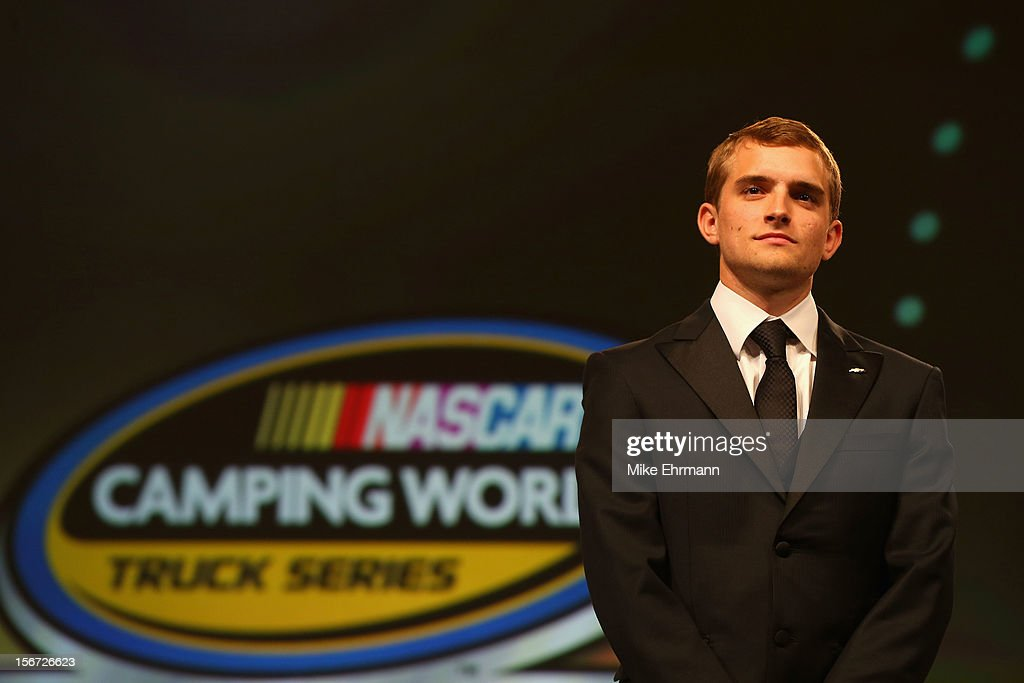 Camping World Truck Series Champion <a gi-track='captionPersonalityLinkClicked' href=/galleries/search?phrase=James+Buescher&family=editorial&specificpeople=5409134 ng-click='$event.stopPropagation()'>James Buescher</a> looks on during the NASCAR Nationwide Series And Camping World Truck Awards Banquet at Loews Miami Beach on November 19, 2012 in Miami Beach, Florida.
