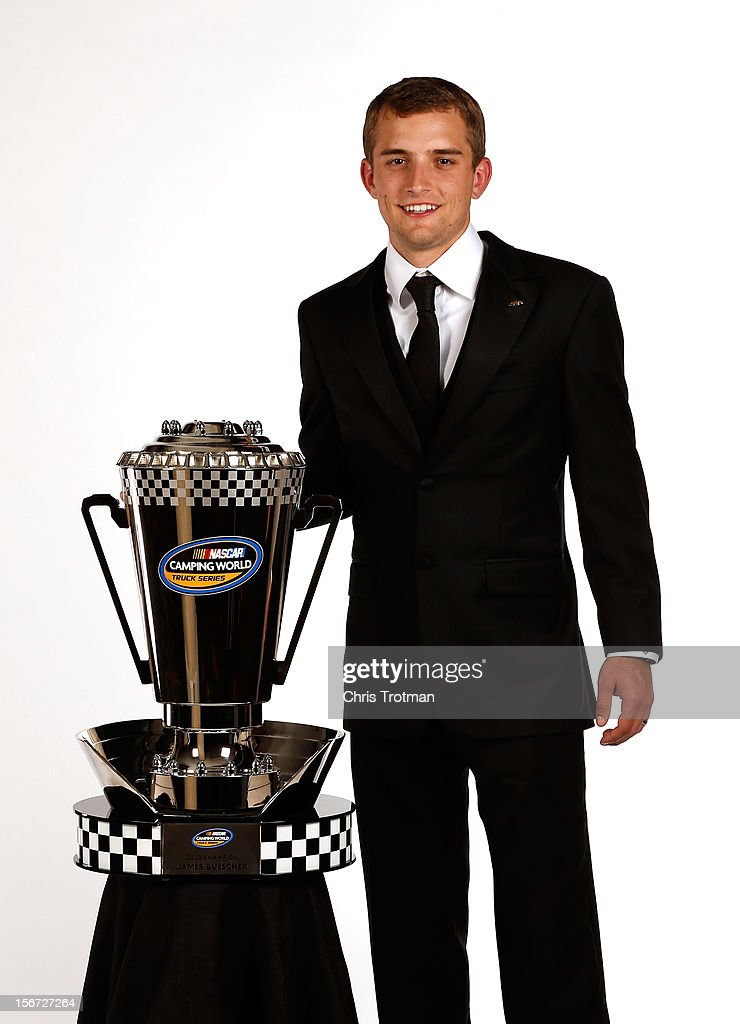 Camping World Truck Series Champion <a gi-track='captionPersonalityLinkClicked' href=/galleries/search?phrase=James+Buescher&family=editorial&specificpeople=5409134 ng-click='$event.stopPropagation()'>James Buescher</a> poses with his trophy during the NASCAR Nationwide Series And Camping World Truck Awards Banquet at Loews Miami Beach on November 19, 2012 in Miami Beach, Florida.