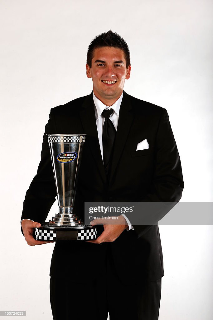Camping World Truck Series driver Joey Coulter poses with the third place trophy during the NASCAR Nationwide Series And Camping World Truck Awards Banquet at Loews Miami Beach on November 19, 2012 in Miami Beach, Florida.