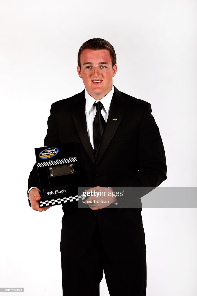 Camping World Truck Series driver <a gi-track='captionPersonalityLinkClicked' href=/galleries/search?phrase=Ty+Dillon&family=editorial&specificpeople=6312493 ng-click='$event.stopPropagation()'>Ty Dillon</a> poses with the fourth place trophy during the NASCAR Nationwide Series And Camping World Truck Awards Banquet at Loews Miami Beach on November 19, 2012 in Miami Beach, Florida.