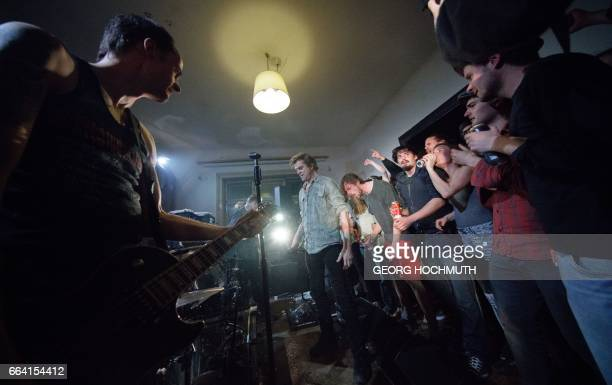 Campino singer of German band Die Toten Hosen performs during a LivingRoomGig in Vienna Austria on April 3 2017 / AFP PHOTO / APA / GEORG HOCHMUTH /...