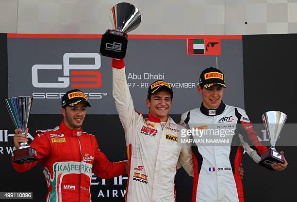 GP3 Campos Raving's Spanish driver Alex Palou GP3 Carlin's Italian driver Antonio Fuoco and GP3 ART Grand Prix's French driver Esteban Ocon celebrate...