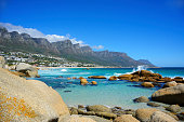 Landscape view of Cape Town Suburb, Camps Bay, on the Atlantic coast with Twelve Apostle mountains in the background