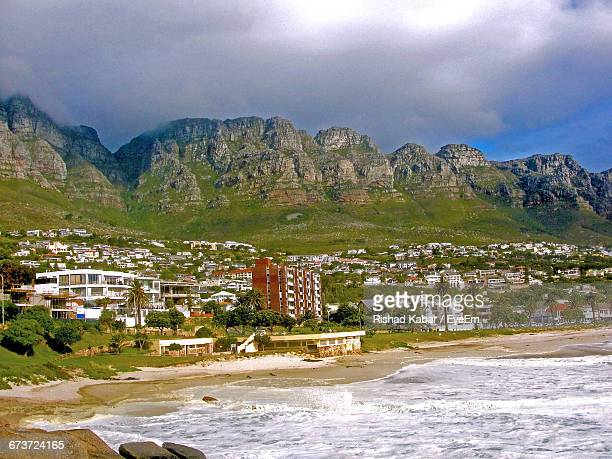 Camps Bay By Sea Shore Against Mountains
