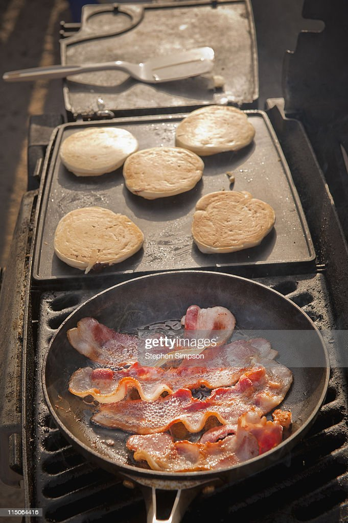 campsite breakfast of bacon and pancakes : Stock Photo